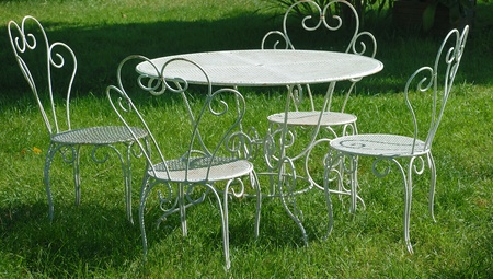 garden table and chairs in summer photo