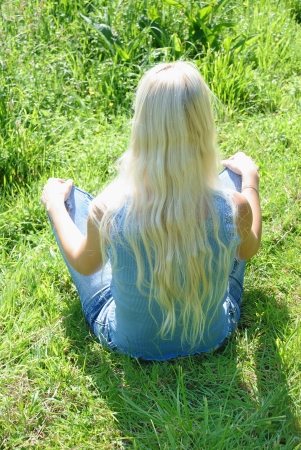 young woman yoga meditation outdoor photo