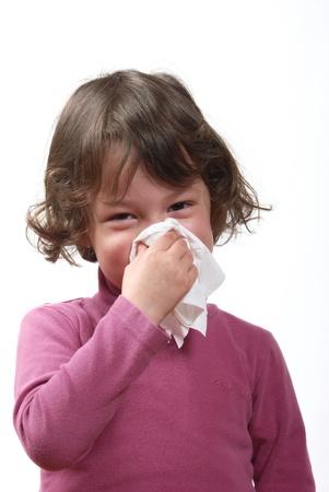 Girl sneezing photo