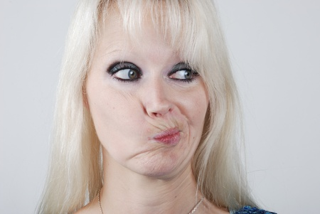 Young blond  woman making a face Stock Photo