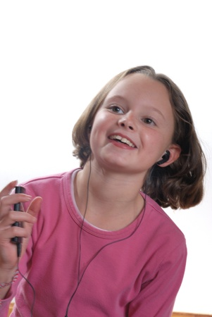 Girl listening to mp3 player Stock Photo - 20771733