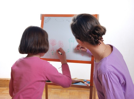 youngs: Youngs girls drawing on the white board