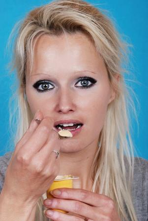 young woman eatin cream