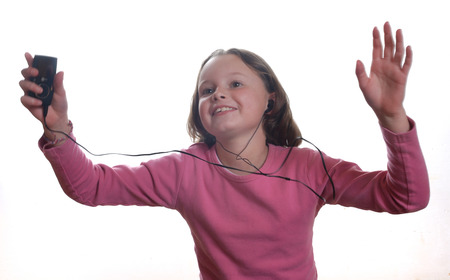 Girl listening to mp3 player Stock Photo - 22189014