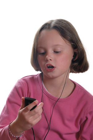 Girl listening to mp3 player Stock Photo - 22841688