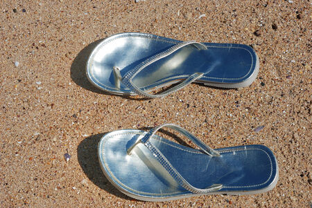 abandonment: woman flip-flops left on the beach Stock Photo