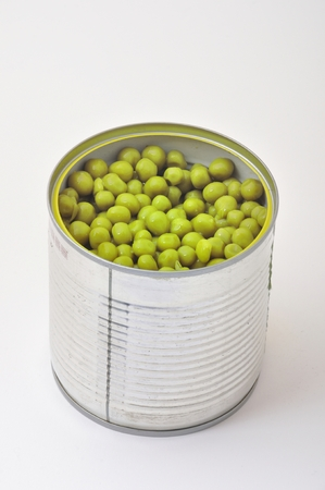 vegetable tin: green peas in  tin can Stock Photo