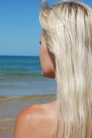 Femme sur la plage Stock Photo