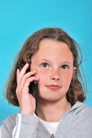 phoning: portrait of teenager phoning
