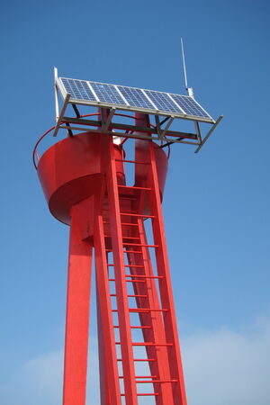 Maritime buoy with solar panel