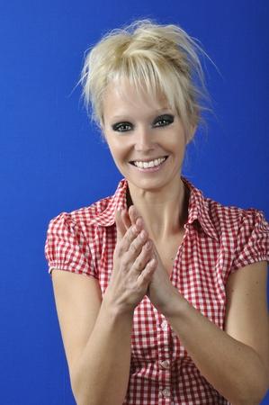 applauding: Blond woman applauding Stock Photo
