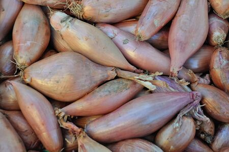 shallots: Shallots at a market stall Stock Photo