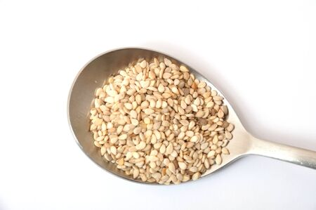 basic food: A spoonful of sesame seeds Stock Photo