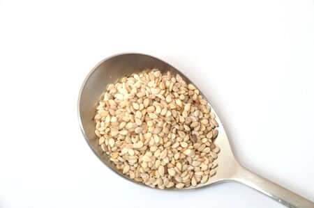 spoonful: A spoonful of sesame seeds Stock Photo