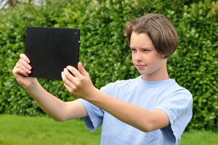 selfy: Girl using digital tablet