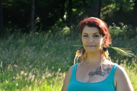 strand: portrait of red  hair woman with strand of wheat Stock Photo