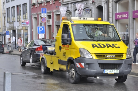 parking violation: Aachen,GERMANY-AUGUST 02, 2014: Pound, removal of a car in the city of Aachen