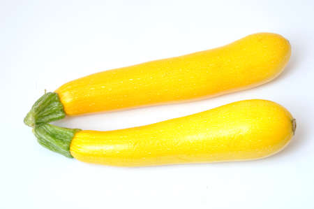 dietetics: Yellow courgettes on white background Stock Photo