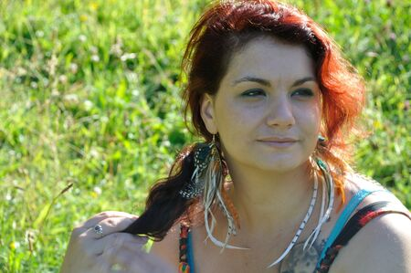 portrait of red  hair woman in a park Stock Photo