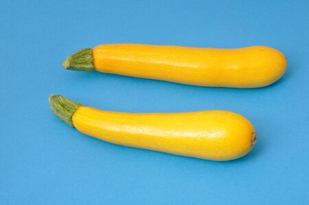 dietetics: Yellow courgettes on blue background