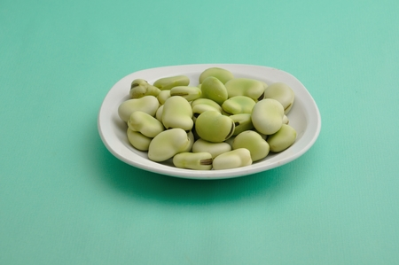 dietetics: Broad beans on a plate Stock Photo