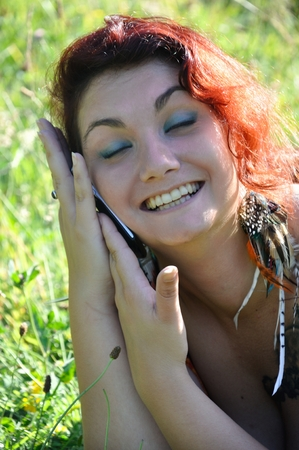 woman phoning in the nature
