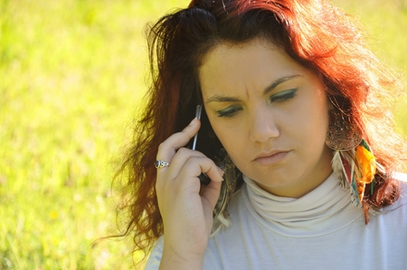 phoning: woman phoning in the nature