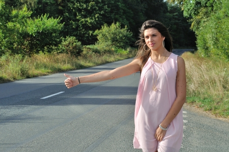 hitchhiking: Woman making hitchhiking in the countryside Stock Photo