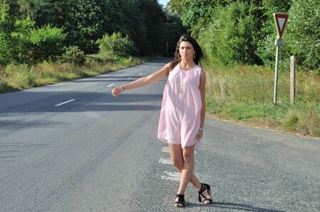 Woman making hitchhiking in the countryside Stock Photo
