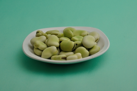 Broad beans on a plate Stock Photo