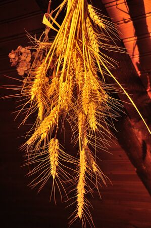 Wheat sheaf attached to a beam