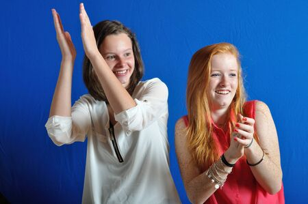 Two girl teens who are applaudissing photo