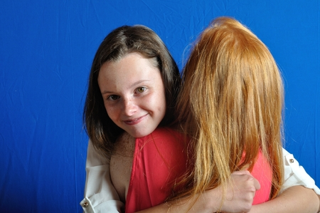 Two teens friends, hugging each other photo