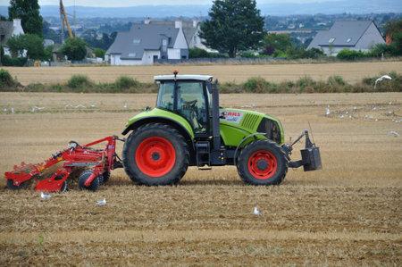PLERIN, FRANCE -August 13 2018 : tractor passing chisel plow at Plerin Editöryel
