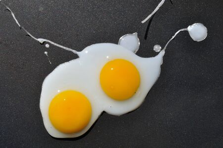 Eggs on plancha Stock Photo