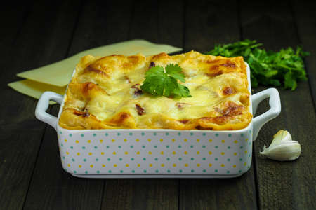 Portion of traditional durum wheat lasagne with bolognaise sauce, beef mince and mozzarella