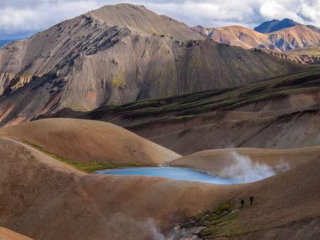 trekkers in colorfull Landmannalaugar - geothermal region in Iceland