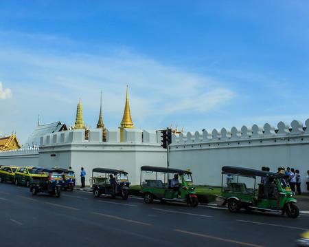 tuktuk: tuktuk in front of temple Editorial