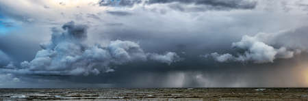 Picture of storm with dramatic clouds at the sea
