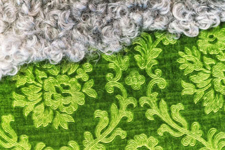 Fur and green textile textures aligning together.