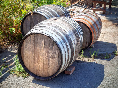 Picture of old wooden vinery barells on the ground Stock Photo