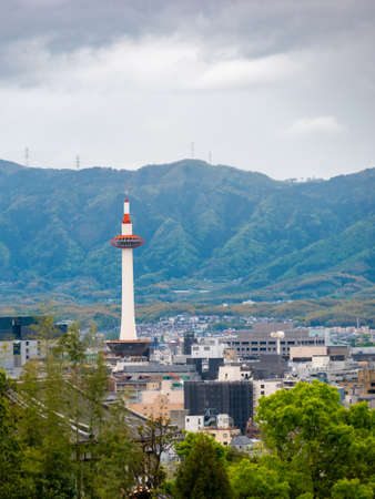 Panoramic Cityscape overview of Kyoto, Japan. Mountains and rainy sky at the background