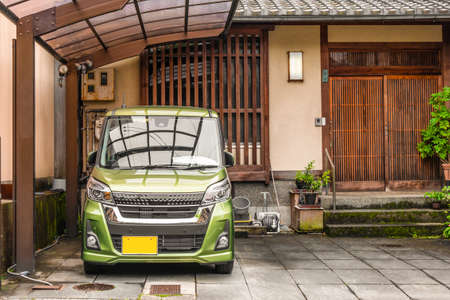 Picture of Japanese Style entrance to the wooden house with kei car type parked in from of it