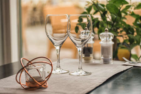 Picture of Served table set at summer terrace cafe with two glasses of wine