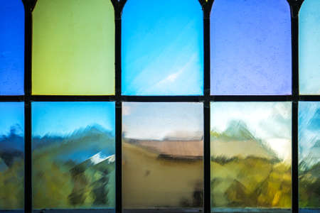 Decorative window with various colored rectangles stained glass