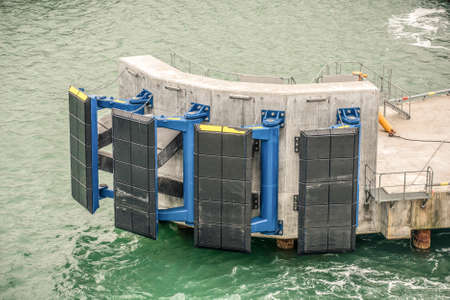 Jetty fender system to protect the jetty from ship damage Stock Photo