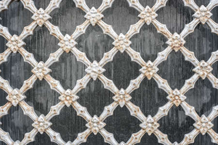 Old vintage steel wire mesh fence wall background