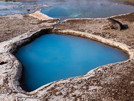Picture of Blue geothermal pond at The Great Geysir, an active volcanic geyser in Southwestern Iceland