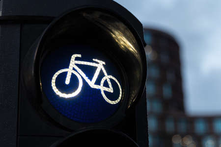 Detail shot of a bicycle traffic light switched to green colour