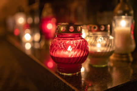 Jars with burning candles on stone surface at night Reklamní fotografie